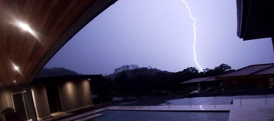 Lightning bolt strikes a few hundred yard away.