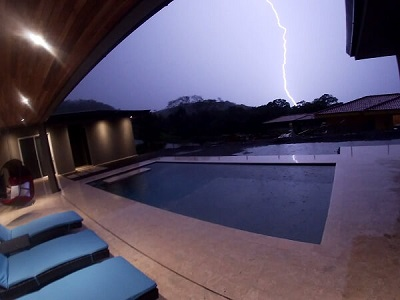 Lightning bolt hits close to our backyard.