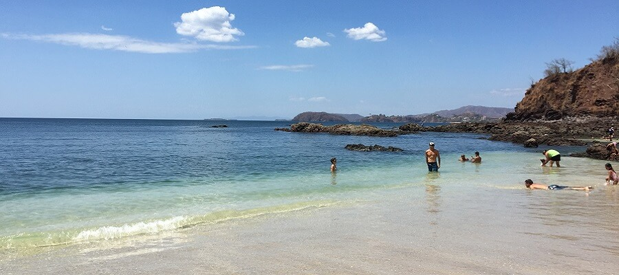 Swimmers enjoy the calm waters at the north end of Playa Conchal.