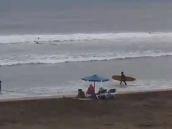 Live view of Costa Rica's famous Tamarindo beach and surf.  This camera scans left to right giving you a view of the entire beach