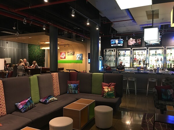 The colorful lobby and bar area at the Aloft San Jose