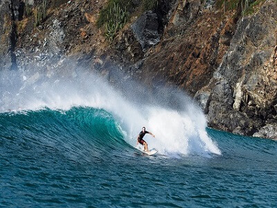 Surfer catches a nice wave in Costa Rica.