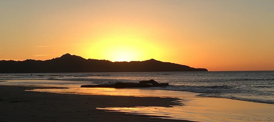 Sun sets over the ocean in Brasilito Costa Rica.