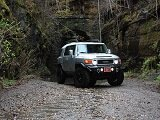Toyota four wheel drive SUV on a dirt road in the jungle